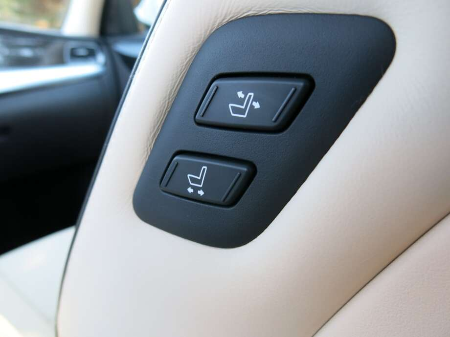 Buttons on the left side of the front passenger seat seatback allow for adjustments so the driver doesn't have to get out of the car, come around to the right side and do it with the adjusters the passenger would normally use.