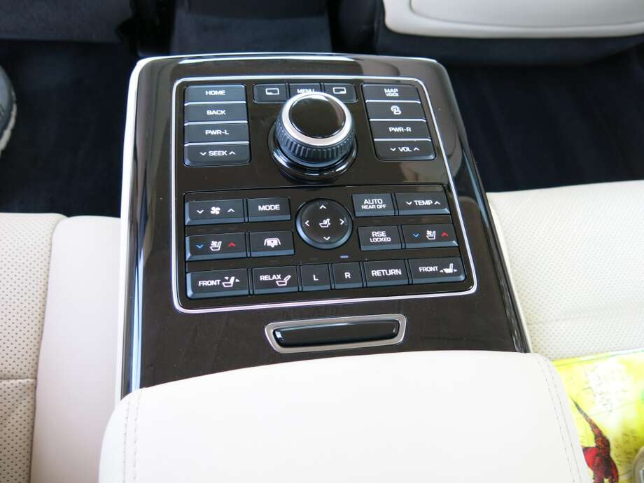 Rear seat passengers get their own control panel, in the form of a center arm rest.