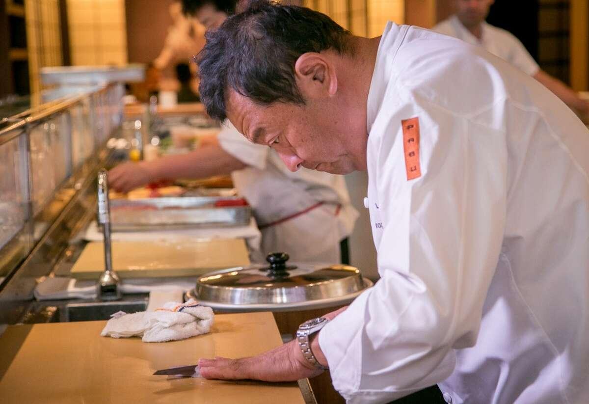 Chef Ken Tominaga prepares sushi at Pabu in San Francisco.