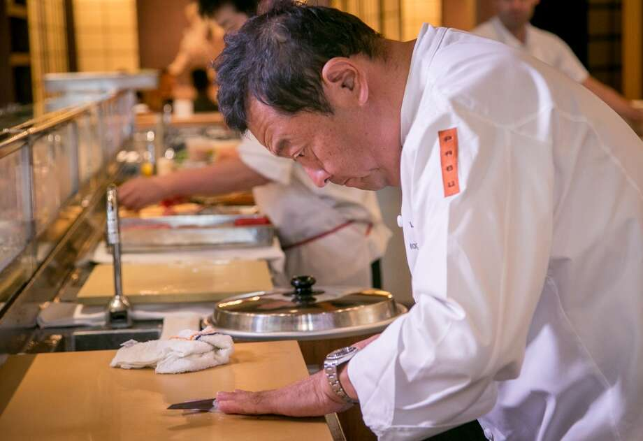 Chef Ken Tominaga prepares sushi at Pabu in San Francisco. Photo: John Storey, Special To The Chronicle