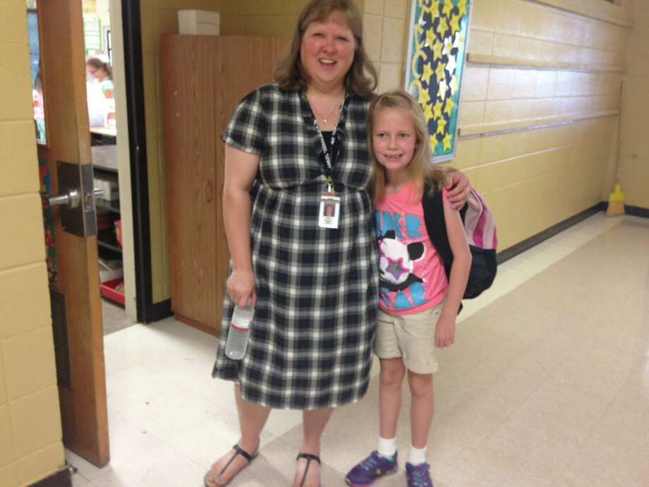 Grace Barger with her third grade teacher Amy Nelson at Highland Park Elementary in Nederland.