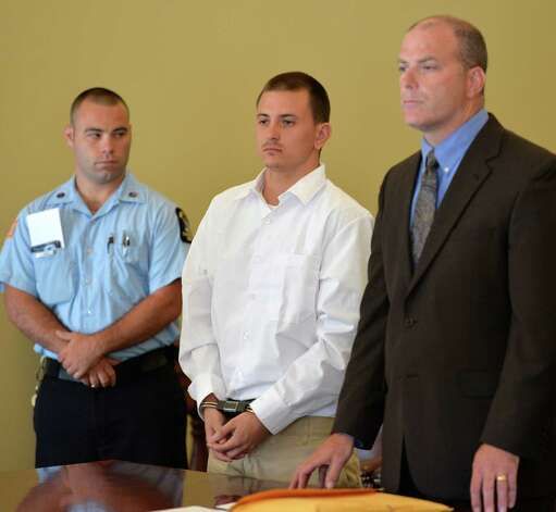 John Halacy, center, is sentenced in Rensselaer County Court Monday morning, Aug. 25, 2014, in Troy, N.Y. He was represented by public defender Art Frost, right. Halacy, whose original rape charges were dismissed last year because of a prosecutorial error, was sentenced to four years in prison. He must register as a sex offender and do three years of post-release supervision. (Skip Dickstein/Times Union) Photo: SKIP DICKSTEIN / 00028315A