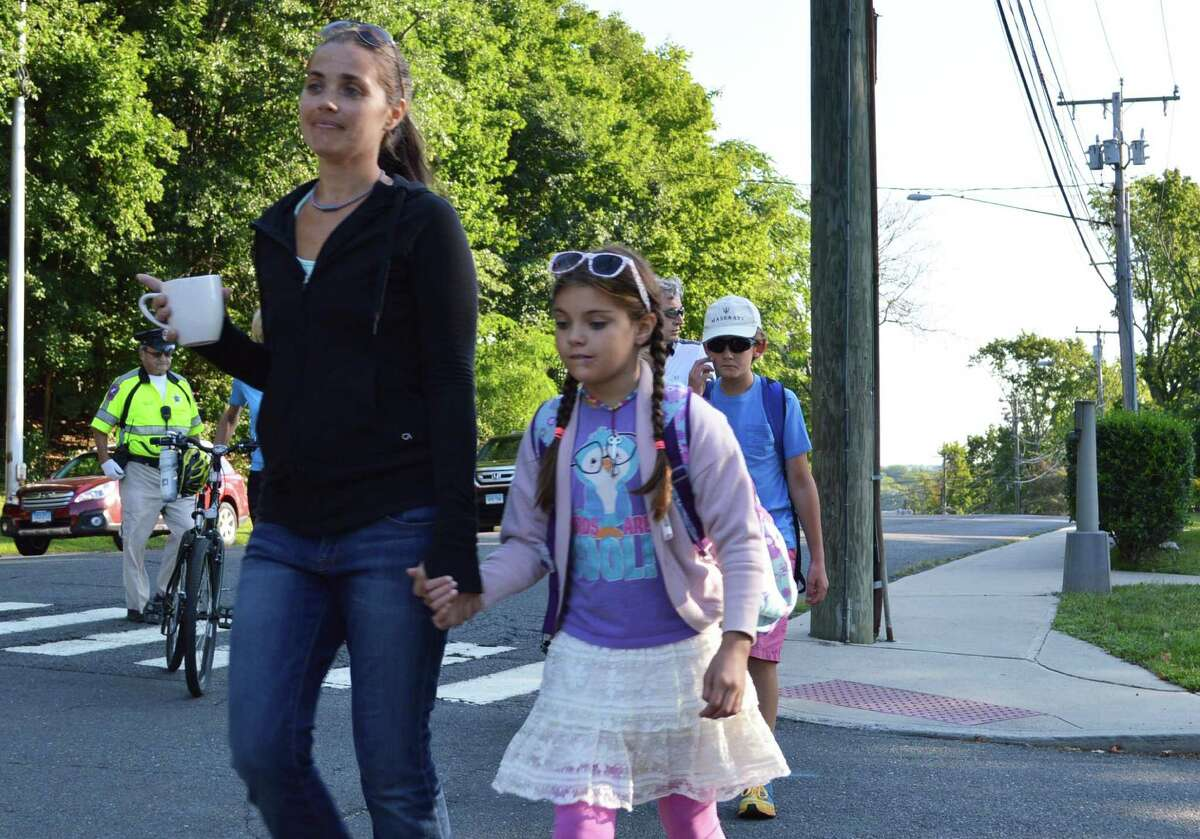 Brieana Kennedy and daughter Kaila, 9, walk to classes at Kings Highway Elementary School on the first day of classes for 2014-15 Monday morning.