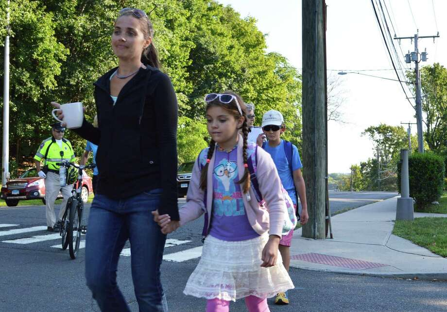 Brieana Kennedy and daughter Kaila, 9, walk to classes at Kings Highway Elementary School on the first day of classes for 2014-15 Monday morning. Photo: Jarret Liotta / Westport News
