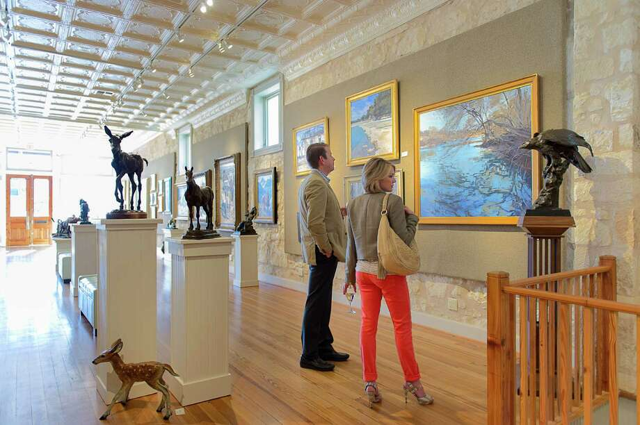Art-lovers visit InSight Gallery during Fredericksburg's First Friday ArtWalk. Photo: Blake Mistich / Blake Mistich