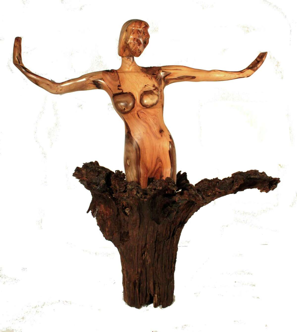 Fredericksburg sculptor Dan Pfeiffer calls this piece Emerging Genesis because he carved her as the beginning of life; she s coming out of the earth.