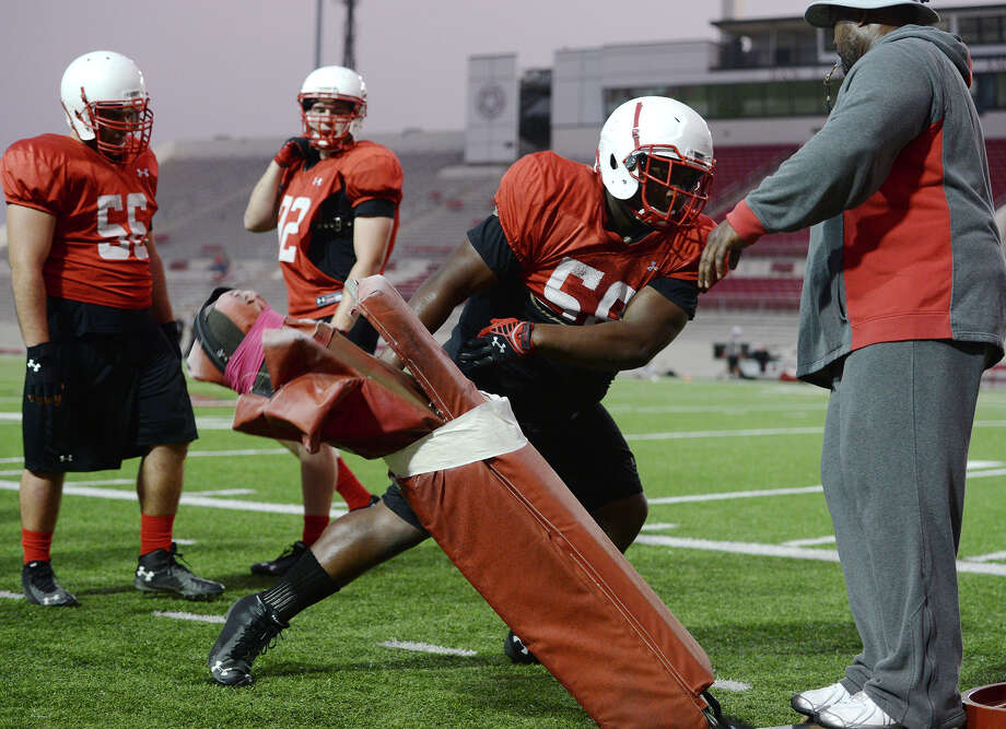 Lamar defensive lineman Omar Tebo runs through a drill during practice Thursday. The Lamar Cardinals football team practiced at Provost Umphrey Stadium on Thursday evening. Photo taken Thursday 8/21/14 Jake Daniels/@JakeD_in_SETX Photo: Jake Daniels / ©2014 The Beaumont Enterprise/Jake Daniels