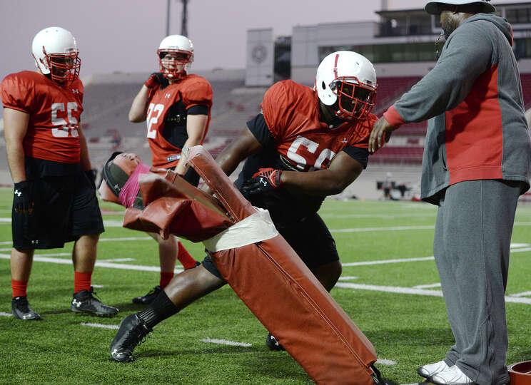 Lamar defensive lineman Omar Tebo runs through a drill during practice Thursday. The Lamar Cardinals