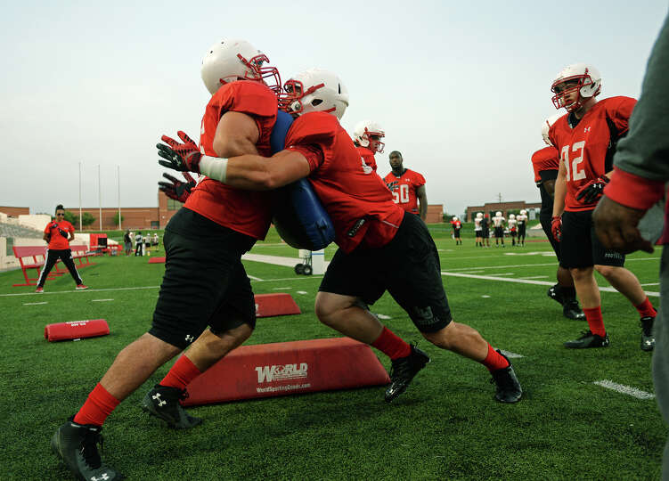 Cardinal defensive linemen go through hitting drills during Thursday's practice. The Lamar Cardinals