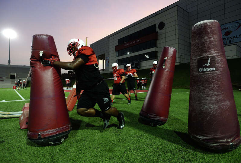Lamar defensive lineman Omar Tebo clubs a bag in passing during practice drills Thursday. The Lamar