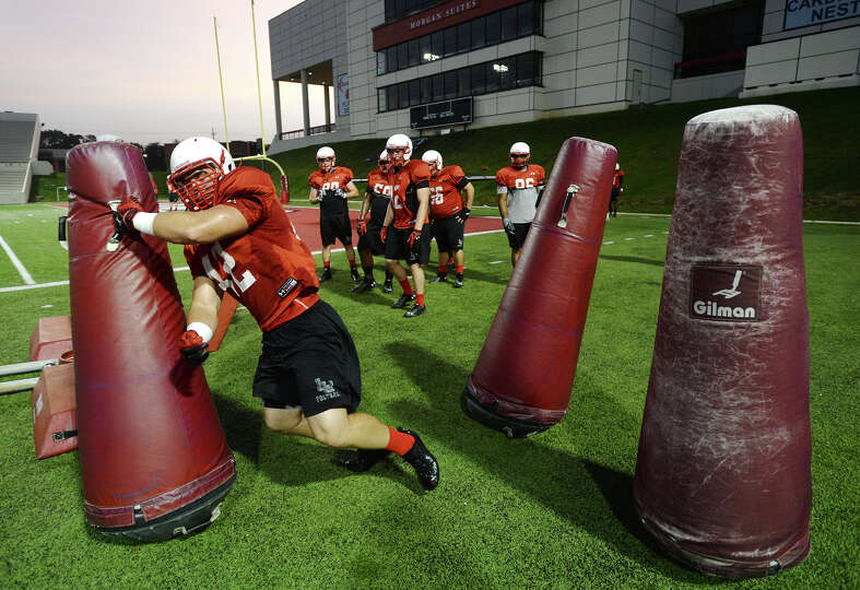 Lamar defensive lineman Keith Curran runs through a drill during Thursday's practice. The Lamar Card