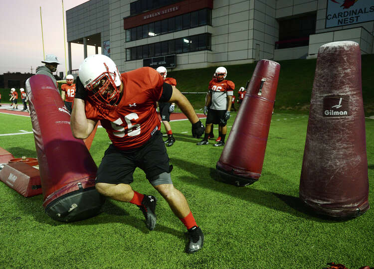 Lamar defensive lineman Seth Adams runs through a drill during practice Thursday. The Lamar Cardinal