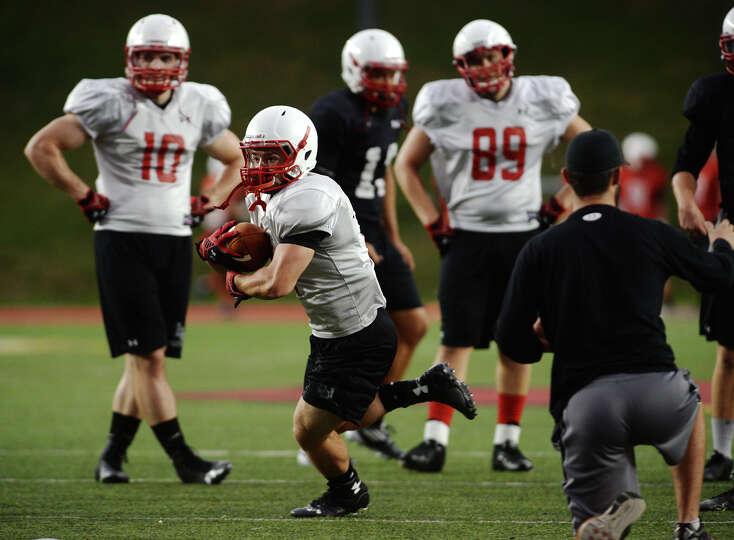 Lamar running back Kade Harrington runs through a drill during practice Thursday. The Lamar Cardinal