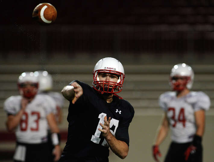 Lamar quarterback Caleb Berry throws to a receiver during practice Thursday. The Lamar Cardinals foo