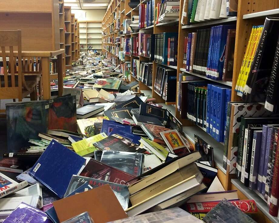 Books were scattered on the floor at Napa High School after Sunday's earthquake left schools in the Napa Valley Unified School District in various states of disarray. School was canceled for students Monday. Photo: Will Kane