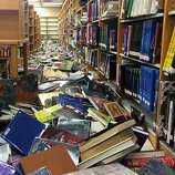 Books were scattered on the floor at Napa High School after Sunday's earthquake left schools in the Napa Valley Unified School District in various states of disarray. School was canceled for students Monday.
