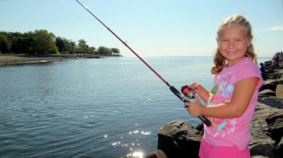 Alexis Robinson, 6, of Westport at the Fairfield Police Athletic League's Snapper Fishing Tourney at South Benson Marina Sunday morning. Photo: Mike Lauterborn / Fairfield Citizen