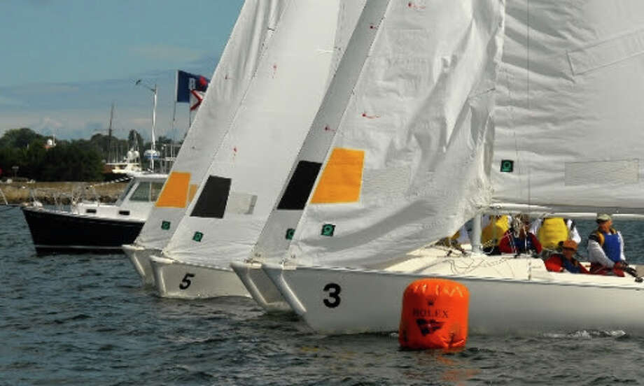 The Noroton Yacht Club (yellow sails) sits on the starting line prior to to one of its 14 wins during the 2014  New York Yacht Club Grandmasters regatta on Aug. 23 and 24 in Newport, R.I. Photo: Contributed / Darien News Contributed
