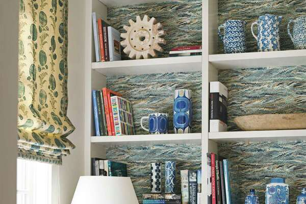 On a Bookcase Twigs' Pheasant wallpaper energizes the broad expanse of shelves in the wife's home office of a house in Houston, Texas. Roman shades are Jasper's Indian Flower. Designer Ann Wolf used the fabric's border to trim the chair. Brilliant Ideas For Your BookshelvesHow to Mix and Match Patterns12 Kids' Room Essentials That (Literally!) Grow With Your Child13 Things A Woman Should Never EVER Have In Her Home11 Questions To Ask Before Buying A Home16 Things A Man Should Never EVER Have In His Home