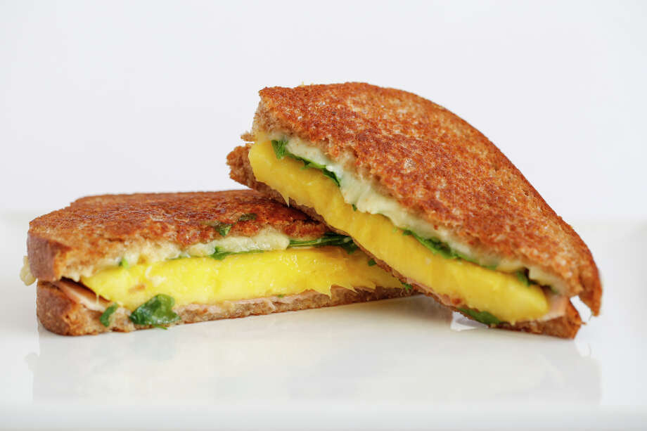 A grilled mango, ham and cheese sandwich Photo: Russell Yip / Russell Yip / The Chronicle / ONLINE_YES
