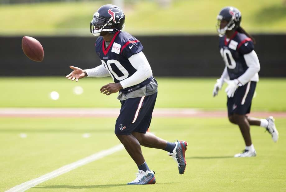 Houston Texans wide receivers Andre Johnson (80) and DeAndre Hopkins (10) run back to the huddle after running a play during Texans practice at the Methodist Training Center Monday, Aug. 25, 2014, in Houston.  ( Brett Coomer / Houston Chronicle ) Photo: Brett Coomer, Houston Chronicle