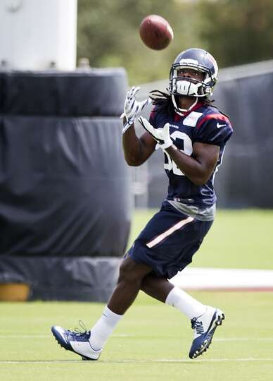 Houston Texans wide receiver Keshawn Martin (82) reaches out to make a catch during Texans practice