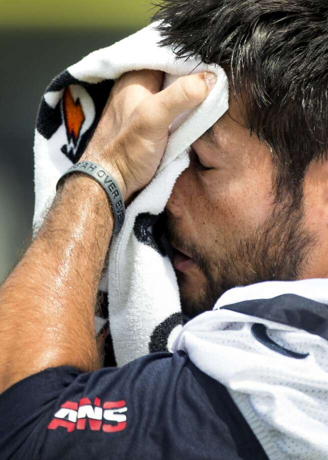 Houston Texans free safety Shiloh Keo wipes his face with a towel during Texans practice at the Methodist Training Center Monday, Aug. 25, 2014, in Houston. The heat index Monday is predicted to be over 100. ( Brett Coomer / Houston Chronicle ) Photo: Brett Coomer, Houston Chronicle