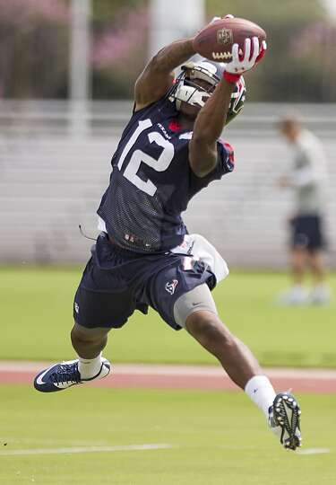 Houston Texans wide receiver Lacoltan Bester leaps to make a catch during Texans practice at the Met