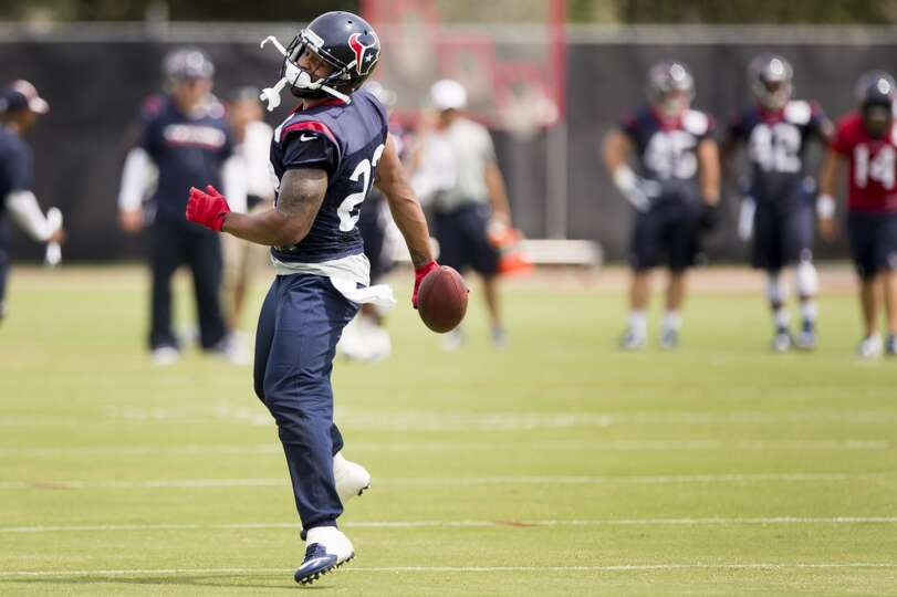 Houston Texans running back Arian Foster (23) turns upfield after making a catch during Texans pract