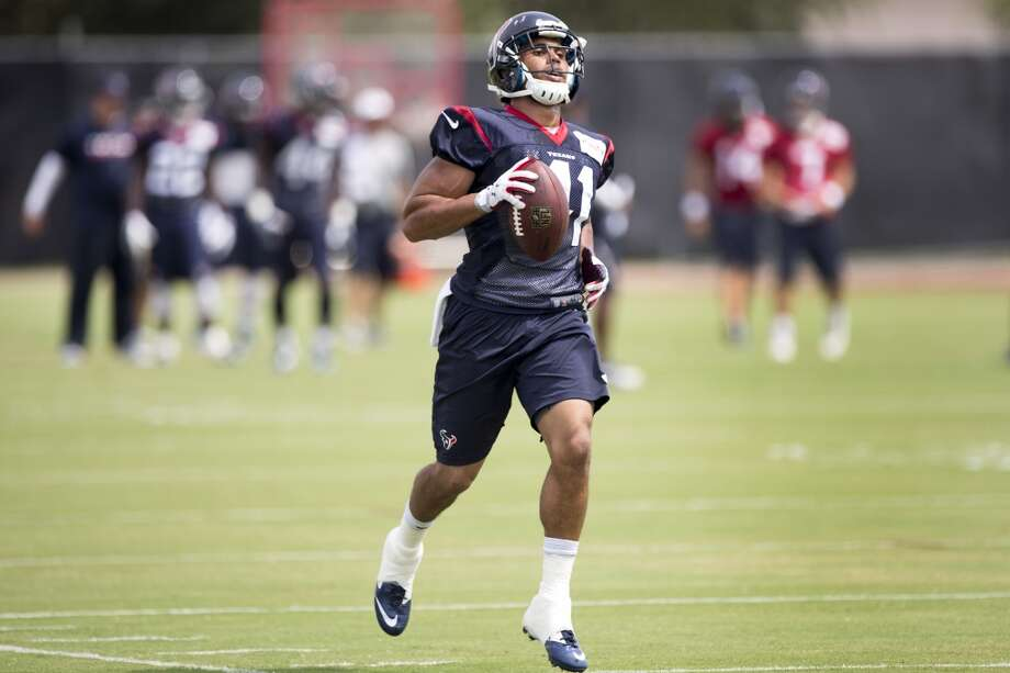 Houston Texans running back Jonathan Grimes runs upfield after making a catch Houston Texans running back Jonathan Grimes runs upfield after making a catch during Texans practice at the Methodist Training Center Monday, Aug. 25, 2014, in Houston.  ( Brett Coomer / Houston Chronicle ) Photo: Brett Coomer, Houston Chronicle