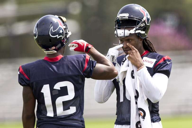 Houston Texans wide receivers Lacoltan Bester (12) and DeAndre Hopkins (10) take a break between dri