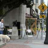 Richard Burquez with his dog Jessie looks at earthquake damage Monday, Aug. 25, 2014, in Napa, Calif. The San Francisco Bay Area's strongest earthquake in 25 years struck the heart of California's wine country early Sunday, igniting gas-fed fires, damaging some of the region's famed wineries and historic buildings, and sending dozens of people to hospitals.