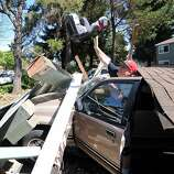 Karl Luchsinger removes a child's car seat from a vehicle after a carport collapsed after a 6.1 earthquake struck Napa, California on Sunday, August 24, 2014. More than 80 people were injured after the quake caused fires, significant structure damage, water main breaks, and power outages throughout the region.