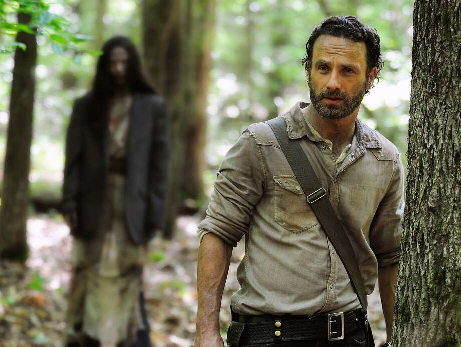 "Andrew Lincoln as Rick Grimes in a scene from season four of ""The Walking Dead."" Photo: Gene Page, Associated Press"