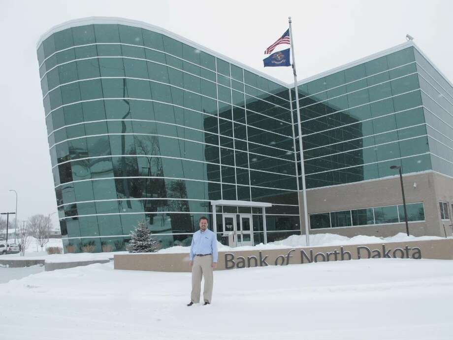 In this photo taken Feb. 5, 2010, Eric Hardmeyer, president of the Bank of North Dakota, poses outside the bank's steamboat-shaped headquarters near the Missouri River. The bank is the only state-owned bank in the nation, and officials in other states are studying whether a state-owned bank could help improve their states' economies. (AP Photo/Dale Wetzel) Photo: Dale Wetzel, AP / AP