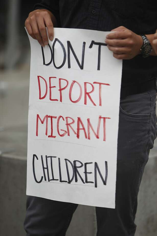 A demonstrator holds a sign during a press conference at the San Francisco Federal Building where immigrant rights groups gathered to demand recognition for children refugees entering the United States on Monday, July 21,  2014 in San Francisco, Calif. Photo: Lea Suzuki, The Chronicle
