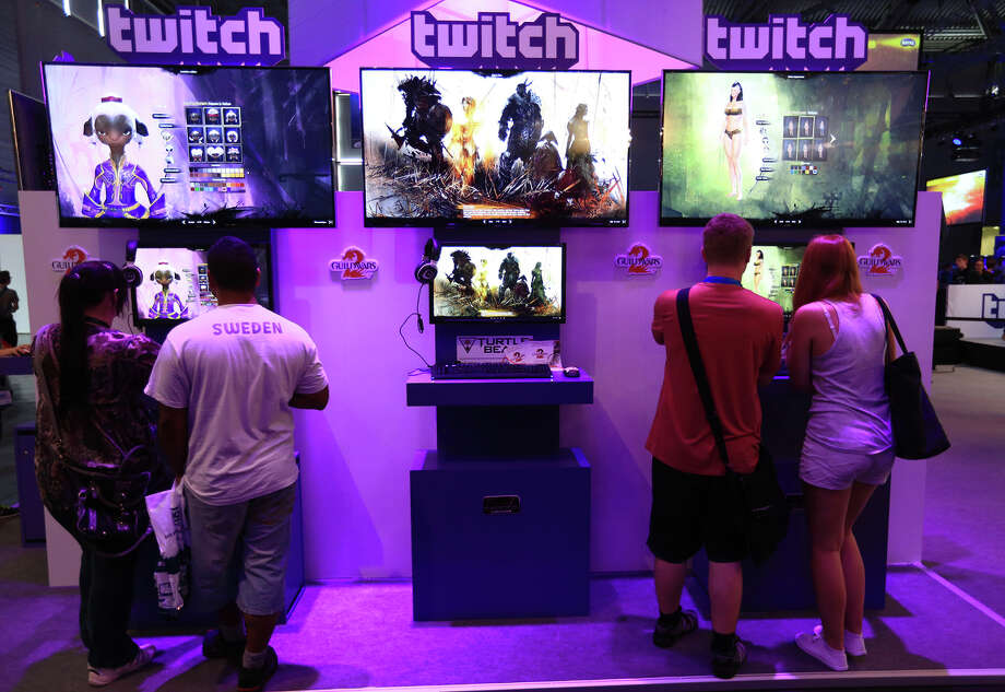 Visitors stream online computer games on the Twitch Interactive Inc. stand at August's Gamescom video games trade fair in Cologne, Germany. Photo: Krisztian Bocsi / Bloomberg / © 2014 Bloomberg Finance