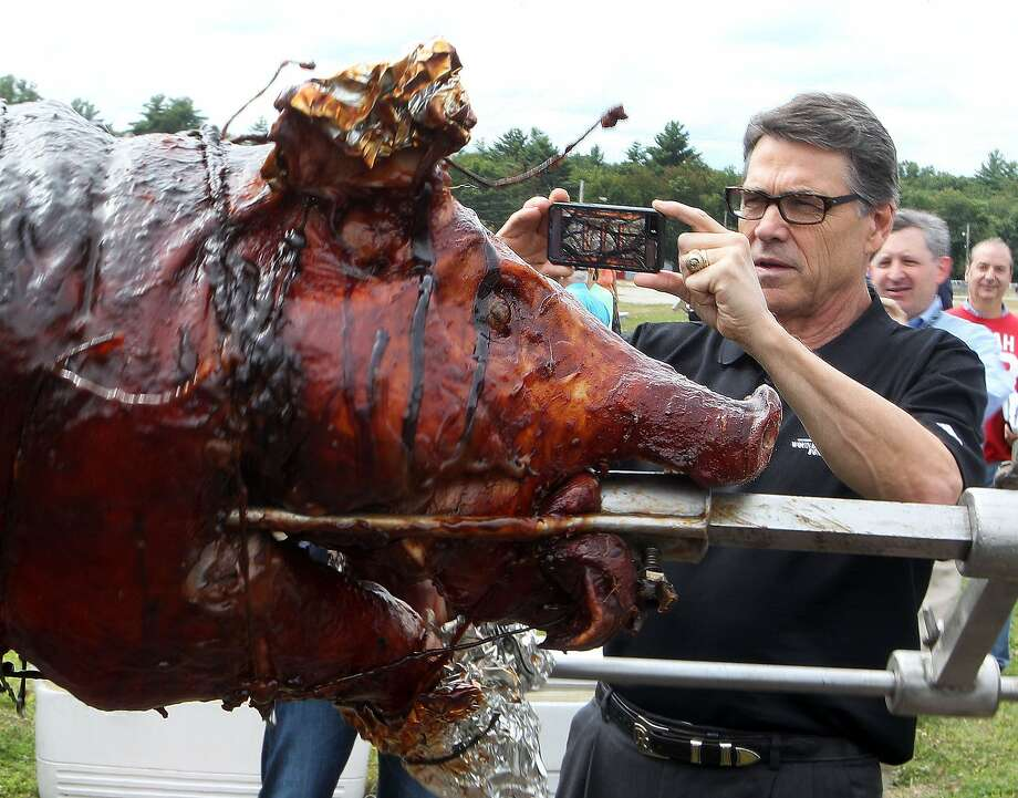 Gov. Rick Perry attended a pig roast during a visit last week to New Hampshire. Photo: Jim Cole, Associated Press