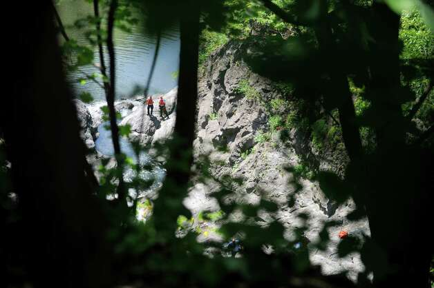 Rescuers take part in a search for a man who went missing in the Poestenkill Gorge on Monday, Aug. 25, 2014, in Troy, N.Y.  (Paul Buckowski / Times Union) Photo: Paul Buckowski / 00028328A
