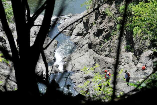 Rescuers search for a man who went missing in the Poestenkill Gorge on Monday, Aug. 25, 2014, in Troy, N.Y.  (Paul Buckowski / Times Union) Photo: Paul Buckowski / 00028328A