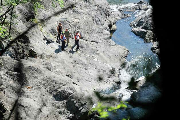 Rescuers, including divers take part in a search for a man who went missing in the Poestenkill Gorge on Monday, Aug. 25, 2014, in Troy, N.Y.  (Paul Buckowski / Times Union) Photo: Paul Buckowski / 00028328A