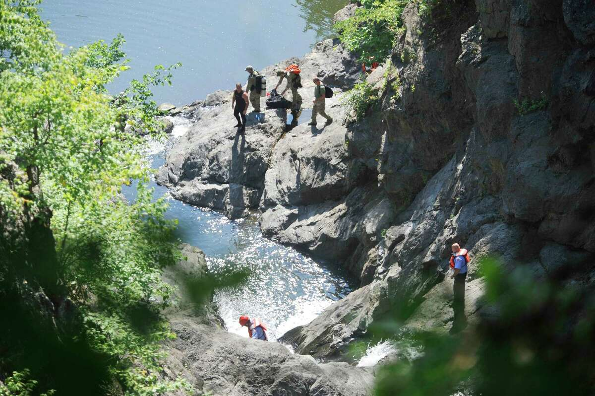 Rescuers, including divers arrive as they take part in a search for a man who went missing in the Poestenkill Gorge on Monday, Aug. 25, 2014, in Troy, N.Y. (Paul Buckowski / Times Union)
