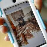 Paula Rosales, the aunt of Nicolas Dillon, shows a picture she took with her smart phone of the bricks that fell on her nephew Monday August 25, 2014. The day after a strong earthquake hit the Napa Valley, residents and officials  began to access the damage.