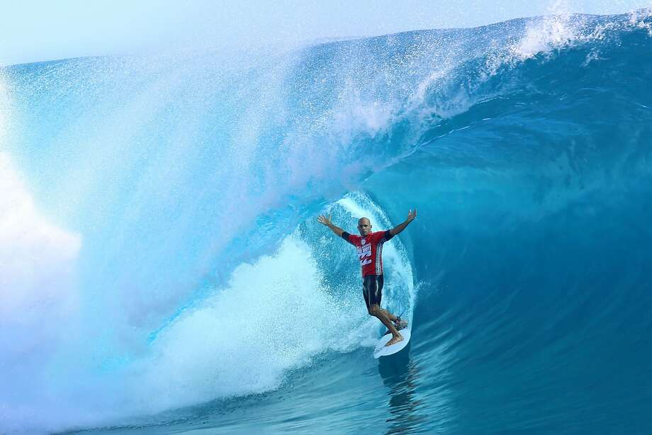 TOPSHOTS USA's Kelly Slater rides a wave during the third day of the 14th edition of the Billabong Pro Tahiti surf event, part of the ASP (Association of Surfing Professionals) world tour, on August 24, 2014  in Teahupoo, on the French Polynesian island of Tahiti. AFP PHOTO / GREGORY BOISSYGREGORY BOISSY/AFP/Getty Images Photo: Gregory Boissy, AFP/Getty Images