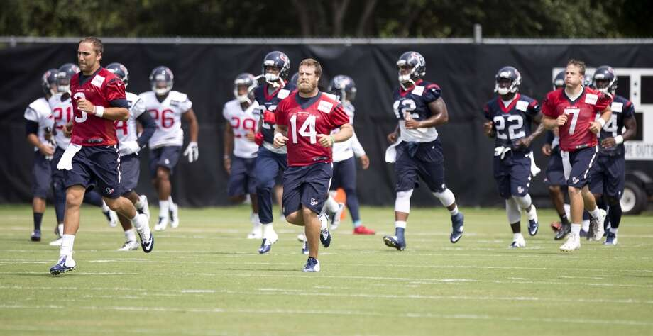 Day 19: August 25   Texans quarterbacks Tom Savage (3),  Ryan Fitzpatrick (14) and Case Keenum (7) run upfield during Texans practice at the Methodist Training Center. Photo: Brett Coomer, Houston Chronicle