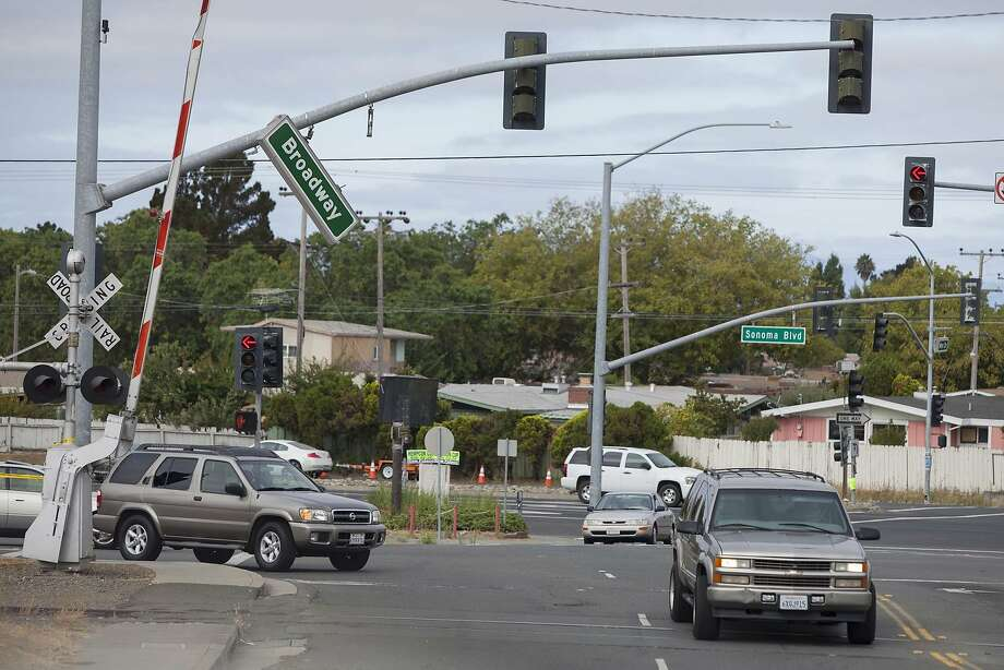 A street sign dangles over a busy Vallejo street after Sunday's 6.0 earthquake in the North Bay. Photo: Alex Washburn, Associated Press