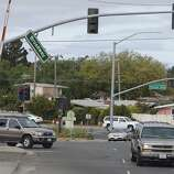 A street sign dangles over a busy street after an earthquake in Vallejo Calif. on Sunday Aug. 24, 2014. A large earthquake caused significant damage and left at least three critically injured in California's northern Bay Area early Sunday, igniting fires, sending at least 87 people to a hospital, knocking out power to tens of thousands and sending residents running out of their homes in the darkness. (AP Photo/Alex Washburn)