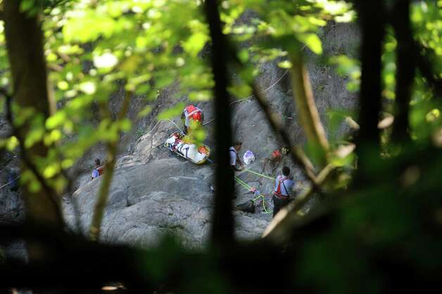 Troy Firefighters pull a basket with the body of a man out of the Poestenkill Gorge on Monday, Aug. 25, 2014, in Troy, N.Y.  (Paul Buckowski / Times Union) Photo: Paul Buckowski / 00028328A