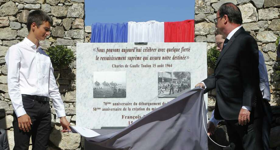French President Francois Hollande (right) unveils a memorial paying tribute to the French Resistance during World War II at the Mont Faron memorial in Toulon, southern France. France celebrated the 70th anniversary of the Allied invasion of its southern coast on Aug. 15. Photo: Michel Euler / Associated Press / AP