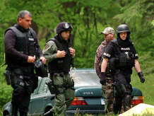 Police at the home on Dogwood Drive, in Easton, Conn. where Gonzalo Guizan was shot and killed by police during a raid on May 18th, 2008.